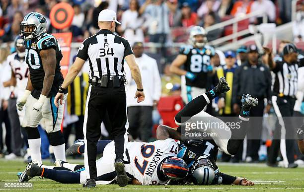 Malik Jackson of the Denver Broncos tackles Cam Newton of the Carolina Panthers in the second quarter during Super Bowl 50 at Levi's Stadium on...