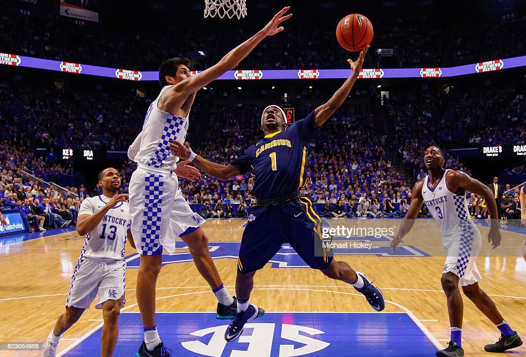 Malik Johnson #1 of the Canisius Golden Griffins shoots the ball as Derek Willis #35 of the Kentucky Wildcats defends at Rupp Arena Stadium on November 13, 2016 in Lexington, Kentucky. Kentucky defeated Canisius 93-69.