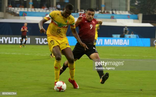 Malik Karaahmet of Turkey is in action against Abdoulaye Diaby of Mali during the ceremony within a 2017 FIFA U-17 World Cup football match between...
