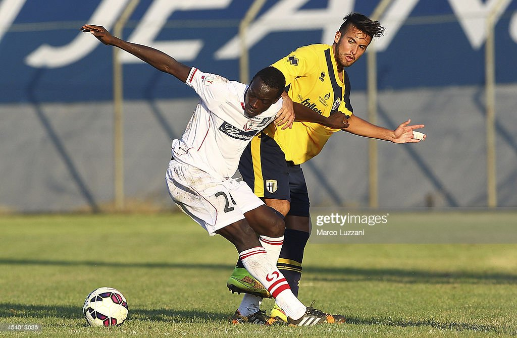 Malik Mbaye of Carpi FC competes for the ball with Cristobal Jorquera of Parma during the pre-season friendly match between Carpi FC and FC Parma at Stadio Sandro Cabassi on August 23, 2014 in Carpi, Italy.