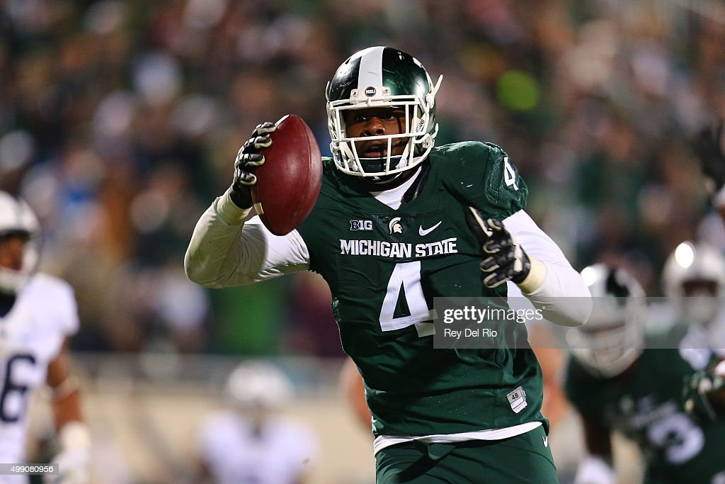 Malik McDowell #4 of the Michigan State Spartans intercepts a pass and returns it for the touchdown in the fourth quarter against the Penn State Nittany Lions at Spartan Stadium on November 28, 2015 in East Lansing, Michigan.