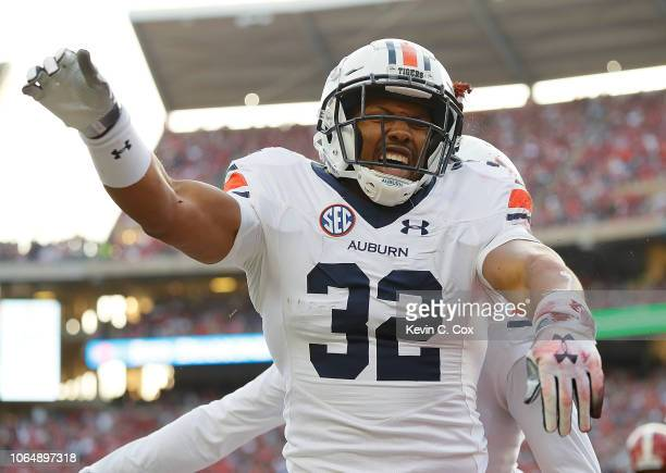 Malik Miller of the Auburn Tigers reacts after diving for a touchdown over Deionte Thompson of the Alabama Crimson Tide at BryantDenny Stadium on...
