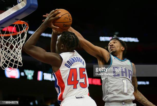 Malik Monk of the Charlotte Hornets defends against Sekou Doumbouya of the Detroit Pistons going to the basket during the second half at Little...