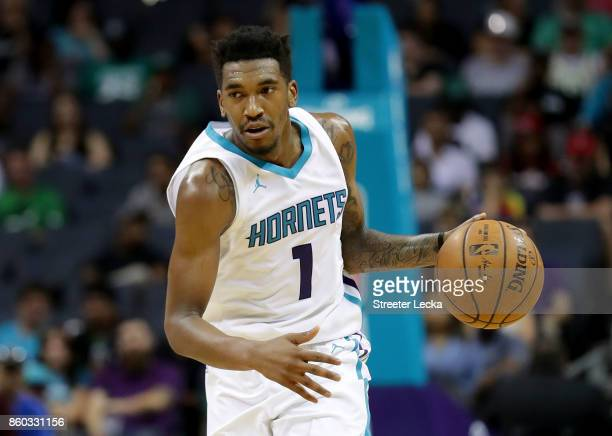 Malik Monk of the Charlotte Hornets drives to the basket against the Boston Celtics during their game at Spectrum Center on October 11 2017 in...