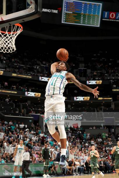 Malik Monk of the Charlotte Hornets dunks the ball against the Milwaukee Bucks during a game on October 17 2018 at Spectrum Center in Charlotte North...