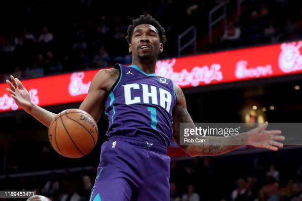 Malik Monk of the Charlotte Hornets dunks the ball against the Washington Wizards in the first half at Capital One Arena on November 22, 2019 in...