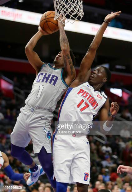 Malik Monk of the Charlotte Hornets goes to the basket against Tony Snell of the Detroit Pistons during the first half at Little Caesars Arena on...