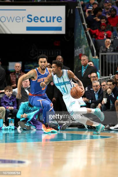 Malik Monk of the Charlotte Hornets handles the ball against the New York Knicks on December 14 2018 at Spectrum Center in Charlotte North Carolina...