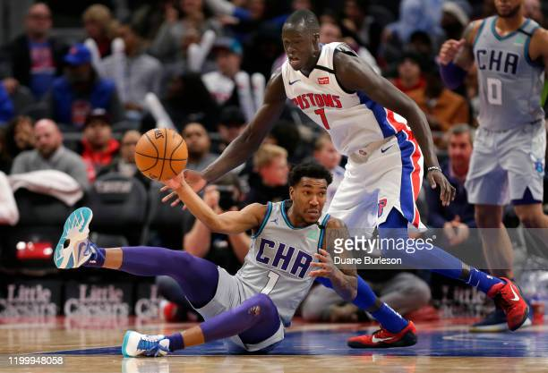 Malik Monk of the Charlotte Hornets passes the ball while being guarded by Thon Maker of the Detroit Pistons during the second half at Little Caesars...