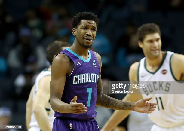 Malik Monk of the Charlotte Hornets reacts after a call against the Milwaukee Bucks during their game at Spectrum Center on November 26 2018 in...