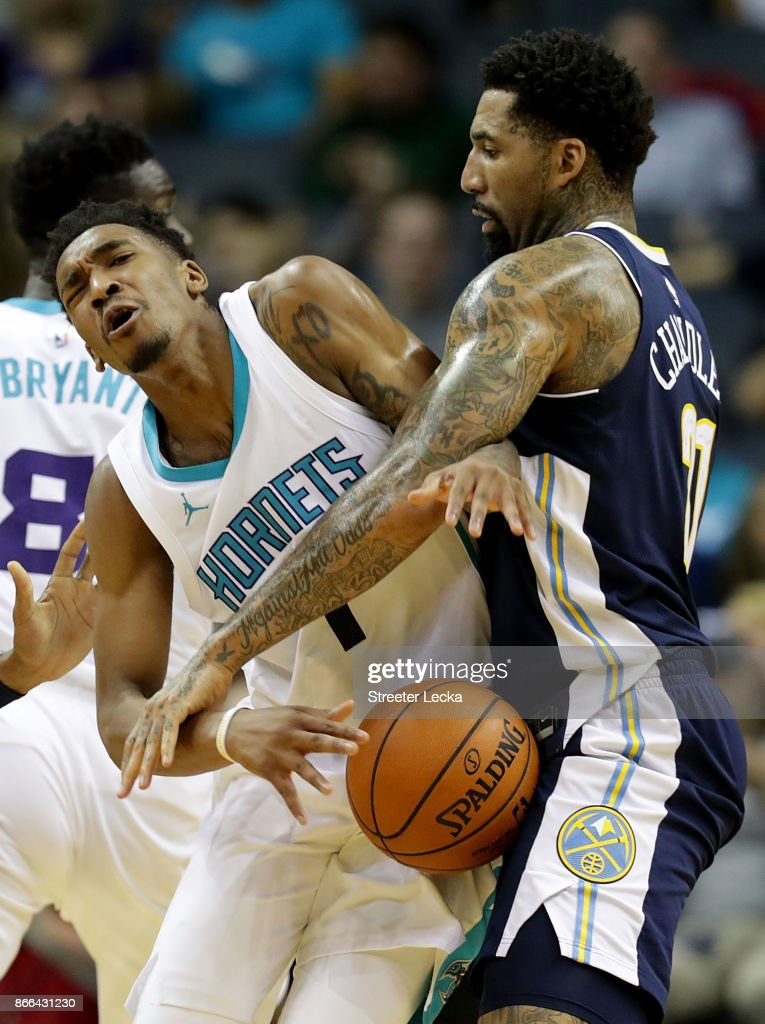 Malik Monk #1 of the Charlotte Hornets runs into Wilson Chandler #21 of the Denver Nuggets during their game at Spectrum Center on October 25, 2017 in Charlotte, North Carolina.