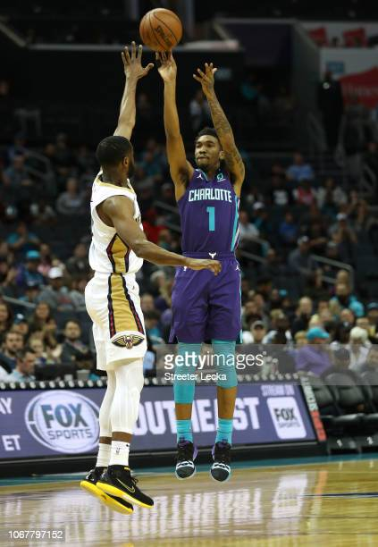 Malik Monk of the Charlotte Hornets shoots against the New Orleans Pelicans during their game at Spectrum Center on December 2 2018 in Charlotte...