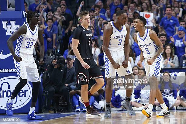 Malik Monk of the Kentucky Wildcats celebrates with Bam Adebayo and Wenyen Gabriel during the first half at Rupp Arena on January 21 2017 in...