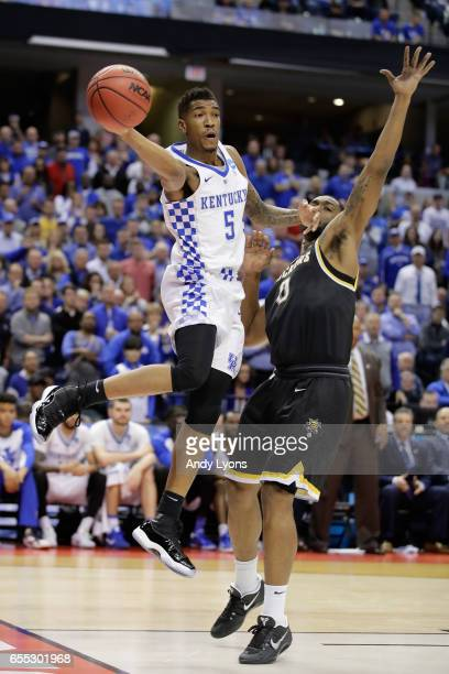 Malik Monk of the Kentucky Wildcats passes against Rashard Kelly of the Wichita State Shockers in the second half during the second round of the 2017...