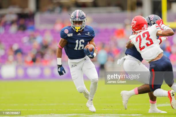 Malik Murray of the Georgia Southern Eagles runs with the ball during the second quarter of the 2019 Cure Bowl against the Liberty Flames at Exploria...