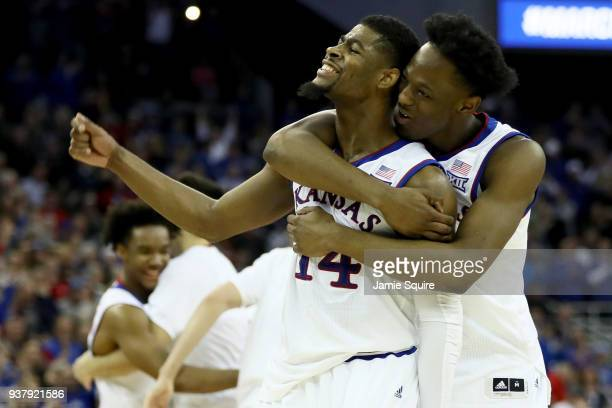 Malik Newman and Marcus Garrett of the Kansas Jayhawks celebrates against the Duke Blue Devils during overtime in the 2018 NCAA Men's Basketball...