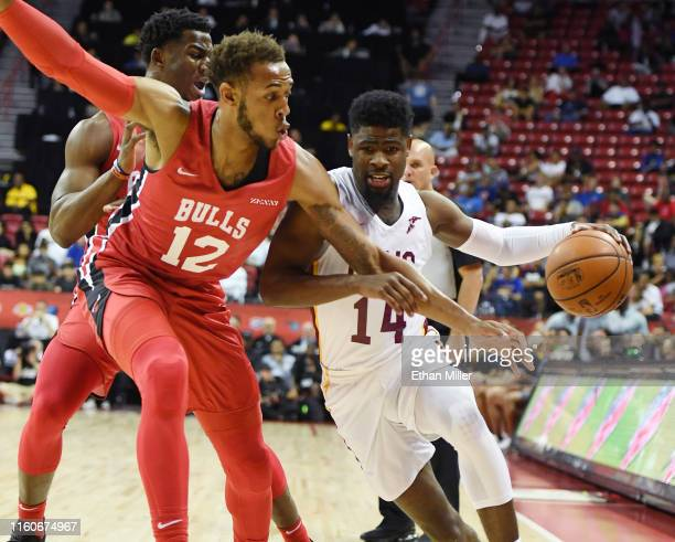 Malik Newman of the Cleveland Cavaliers drives against Daniel Gafford of the Chicago Bulls during the 2019 NBA Summer League at the Thomas & Mack...