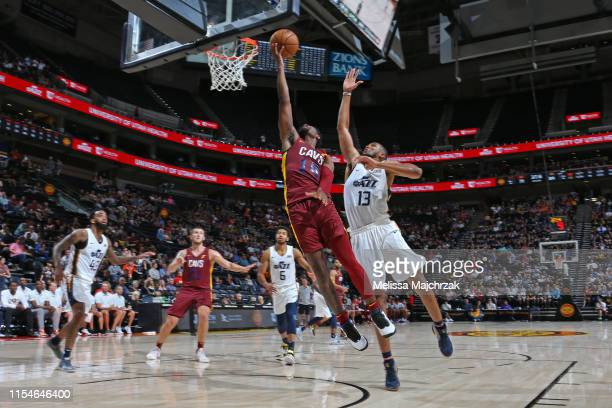 Malik Newman of the Cleveland Cavaliers drives to the basket during the game against Tony Bradley of the Utah Jazz on July 2 2019 at vivintSmartHome...
