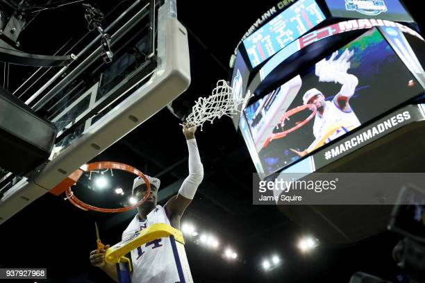 Malik Newman of the Kansas Jayhawks celebrates cutting down the net after defeating the Duke Blue Devils with a score of 81 to 85 in the 2018 NCAA...