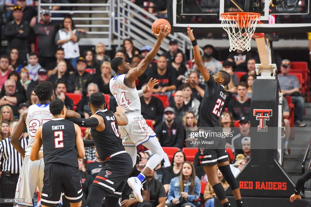 Malik Newman #14 of the Kansas Jayhawks goes to the basket and shoots over Jarrett Culver #23 of the Texas Tech Red Raiders during the first half of the game on February 24, 2018 at United Supermarket Arena in Lubbock, Texas.