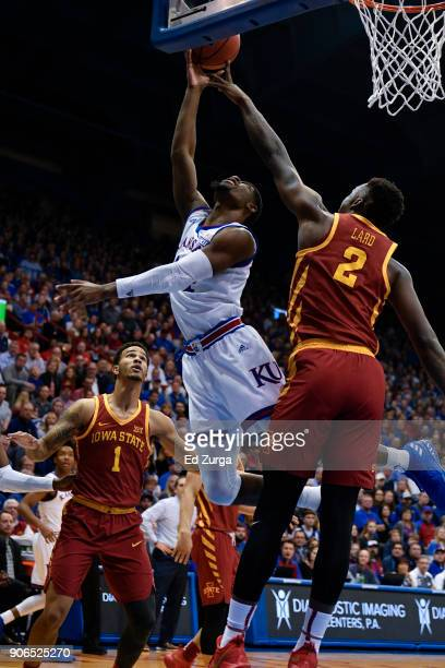 Malik Newman of the Kansas Jayhawks has his shot blocked by Cameron Lard of the Iowa State Cyclones at Allen Fieldhouse on January 9 2018 in Lawrence...