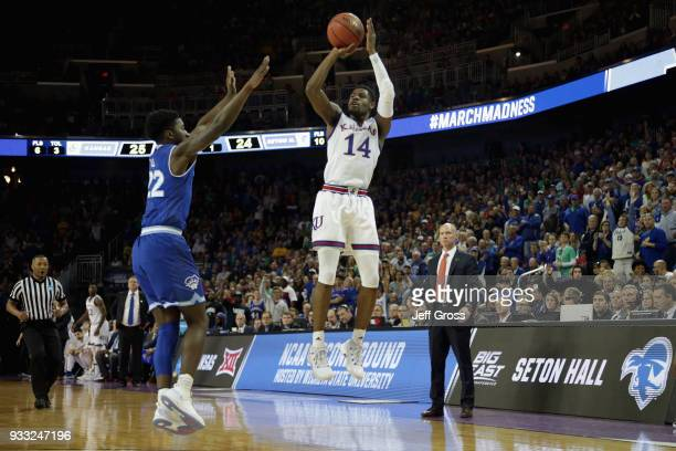 Malik Newman of the Kansas Jayhawks shoots a jump shot against Myles Cale of the Seton Hall Pirates in the first half during the second round of the...