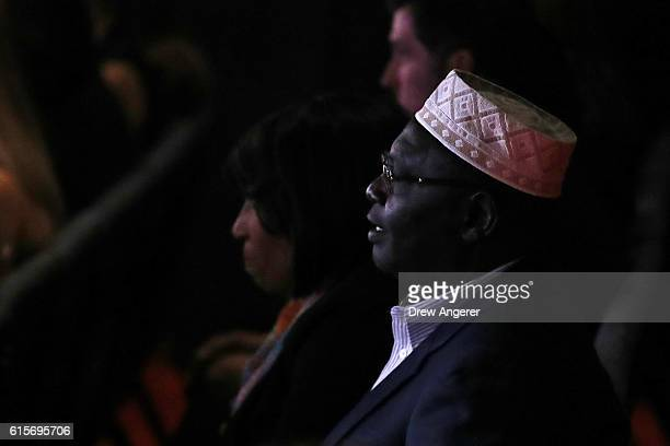 Malik Obama President Barack Obama's Kenyanborn halfbrother listens to the candidates speak during the third US presidential debate at the Thomas...