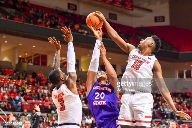 Malik Ondigo of the Texas Tech Red Raiders blocks the shot of Ishmael Lane of the Northwestern State Demons during the first half of the game on...