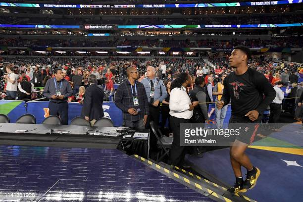 Malik Ondigo of the Texas Tech Red Raiders runs out to the courts before the game against the Virginia Cavaliers during the 2019 NCAA men's Final...