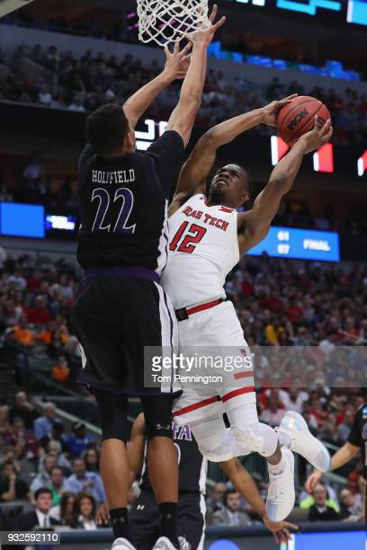 Malik Ondigo of the Texas Tech Red Raiders shoots against TJ Holyfield of the Stephen F Austin Lumberjacks in the second half in the first round of...