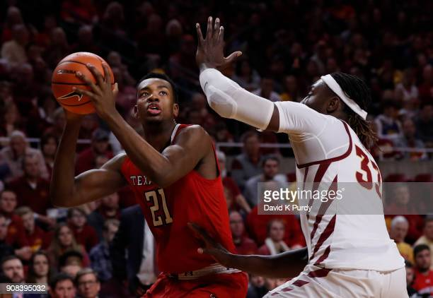 Malik Ondigo of the Texas Tech Red Raiders takes a shot as Solomon Young of the Iowa State Cyclones blocks in the second half of play at Hilton...