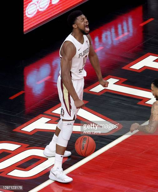 Malik Osborne of the Florida State Seminoles celebrates after dunking the ball against the Louisville Cardinals at KFC YUM! Center on January 18,...