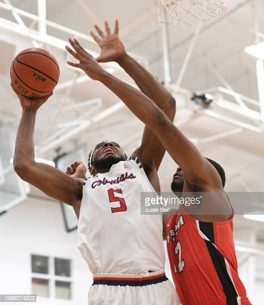 Malik Petteway of the Robert Morris Colonials goes to the basket against Alex Holcombe of the Youngstown State Penguins during the second half in the...
