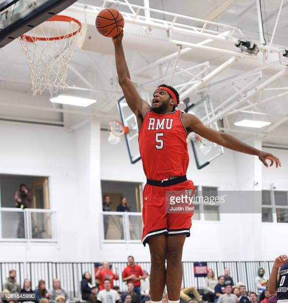 Malik Petteway of the Robert Morris Colonials slam dunks during the second half in the game against the Mount Aloysius Mounties at the North Athletic...
