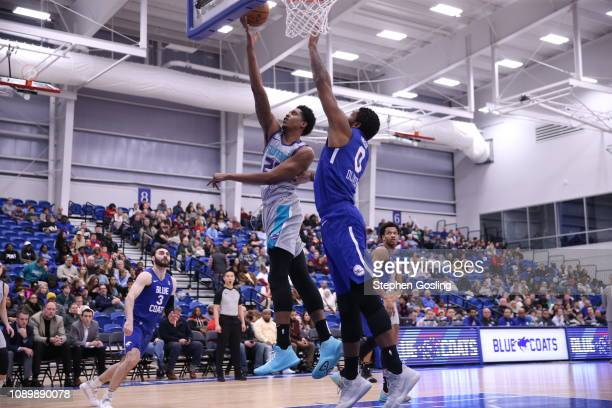 Malik Pope of the Greensboro Swarm shoots against Cameron Oliver of the Delaware Blue Coats during an NBA GLeague game at the 76ers Fieldhouse Elite...