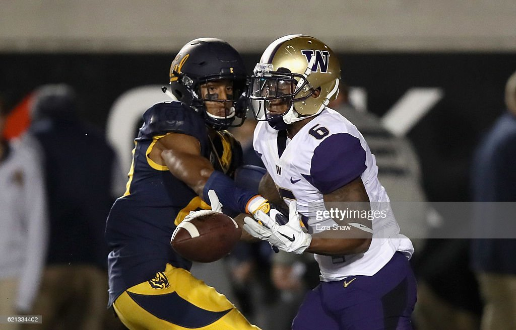 Malik Psalms #23 of the California Golden Bears is called for pass interference while trying to defend Chico McClatcher #6 of the Washington Huskies at California Memorial Stadium on November 5, 2016 in Berkeley, California.