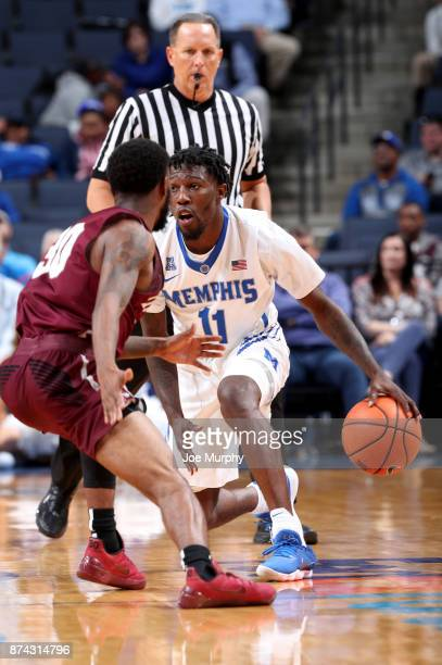 Malik Rhodes of the Memphis Tigers dribbles the ball up court against Anthony Black of the Little Rock Trojans on November 14 2017 at FedExForum in...