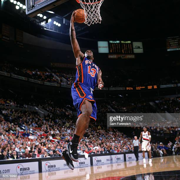 Malik Rose of the New York Knicks takes the ball to the basket during a game against the Portland Trail Blazers at The Rose Garden on March 26, 2005...