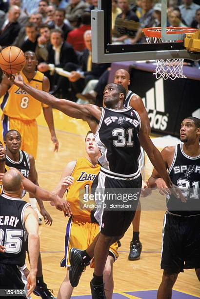 Malik Rose of the San Antonio Spurs grabs a rebound during the NBA game against the Los Angeles Lakers at Staples Center on October 29 2002 in Los...