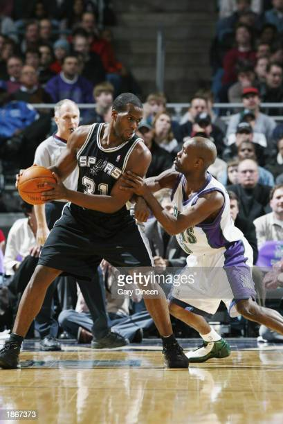 Malik Rose of the San Antonio Spurs is defended by Gary Payton of the Milwaukee Bucks during the game at Bradley Center on March 11 2003 in Milwaukee...