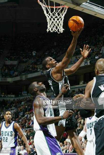 Malik Rose of the San Antonio Spurs shoots against the Milwaukee Bucks during the game at Bradley Center on March 11 2003 in Milwaukee Wisconsin The...