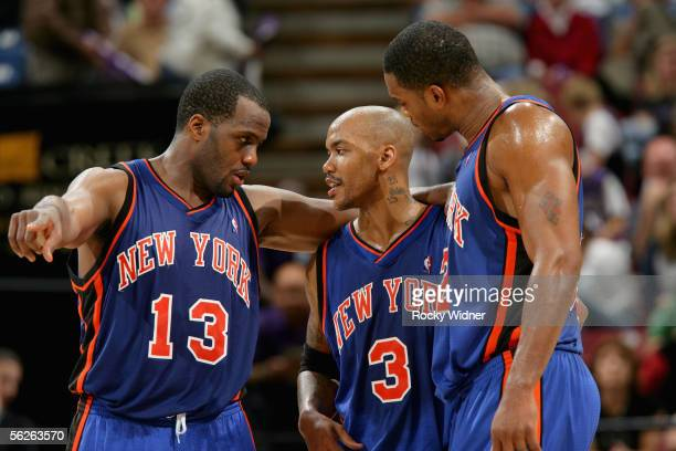 Malik Rose Stephon Marbury and Antonio Davis of the New York Knicks huddle together during a break in the game against the Sacramento Kings at Arco...