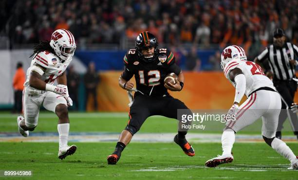 Malik Rosier of the Miami Hurricanes carries during the first quarter of the 2017 Capital One Orange Bowl against the Wisconsin Badgers at Hard Rock...
