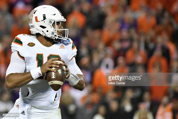 Malik Rosier of the Miami Hurricanes drops back to pass against the Clemson Tigers during the ACC Football Championship at Bank of America Stadium on...