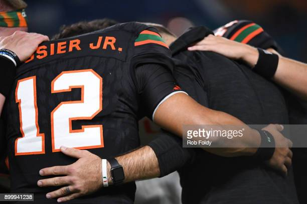 Malik Rosier of the Miami Hurricanes huddles before the 2017 Capital One Orange Bowl against the Wisconsin Badgers at Hard Rock Stadium on December...