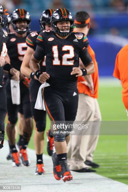 Malik Rosier of the Miami Hurricanes leads the offense onto the field to warm up prior to the 2017 Capital One Orange Bowl against the Wisconsin...