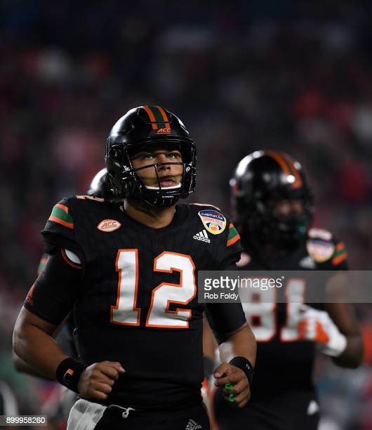 Malik Rosier of the Miami Hurricanes looks on after the first half of the 2017 Capital One Orange Bowl against the Wisconsin Badgers at Hard Rock...