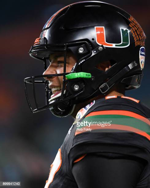 Malik Rosier of the Miami Hurricanes looks on before the 2017 Capital One Orange Bowl against the Wisconsin Badgers at Hard Rock Stadium on December...