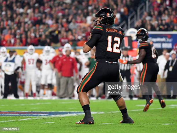 Malik Rosier of the Miami Hurricanes looks to throw during the first quarter of the 2017 Capital One Orange Bowl against the Wisconsin Badgers at...