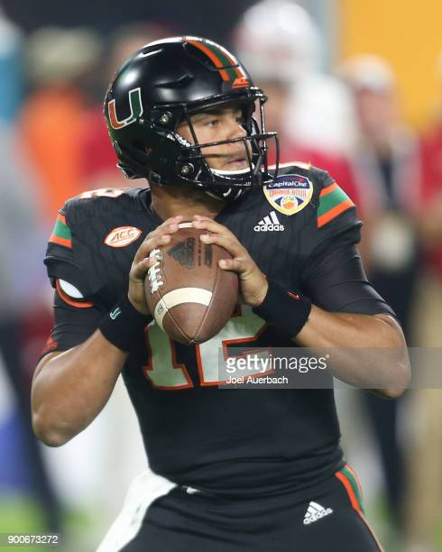 Malik Rosier of the Miami Hurricanes looks upfield as he prepares to throw the ball against the Wisconsin Badgers during the 2017 Capital One Orange...